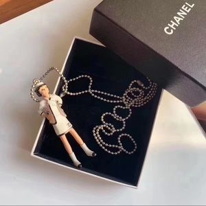 Vintage Chanel doll necklace